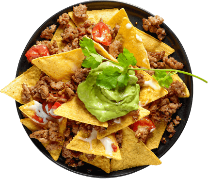 Plate of nachos with a generous serving of AvoFresh avocado on top